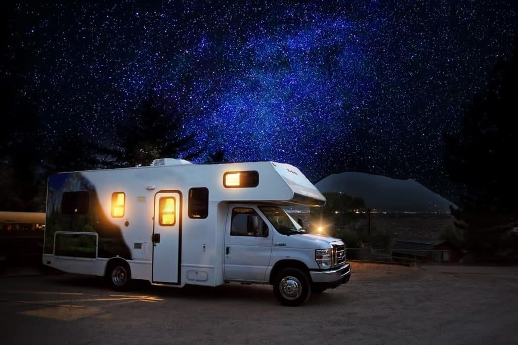 RV at nighttime with stars in background