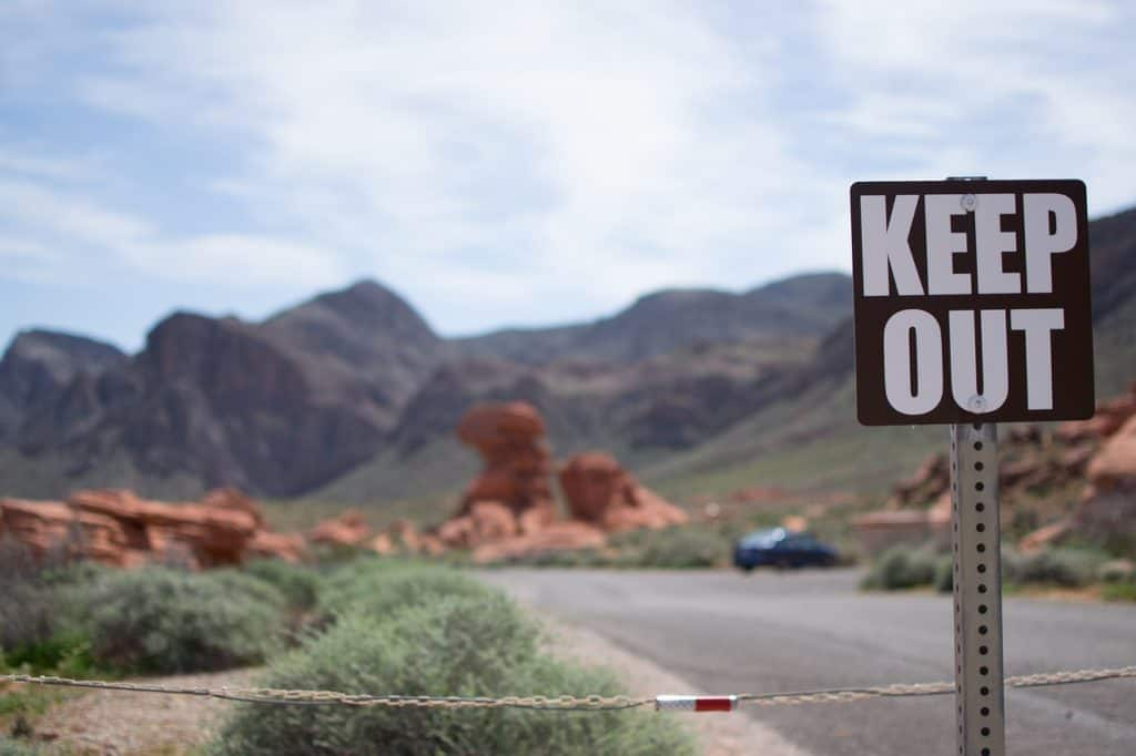 Keep out sign with desert background