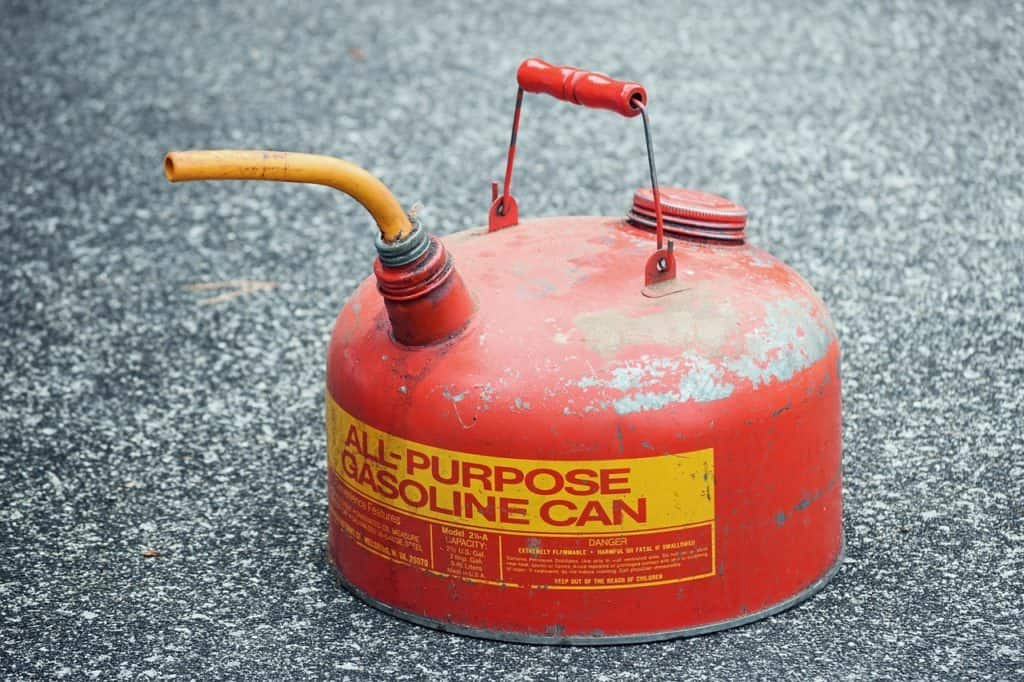 Metal gasoline can on gravel background