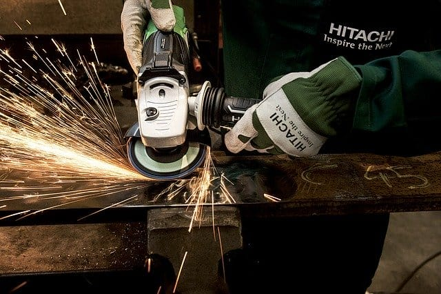 Power tool in use with sparks flying
