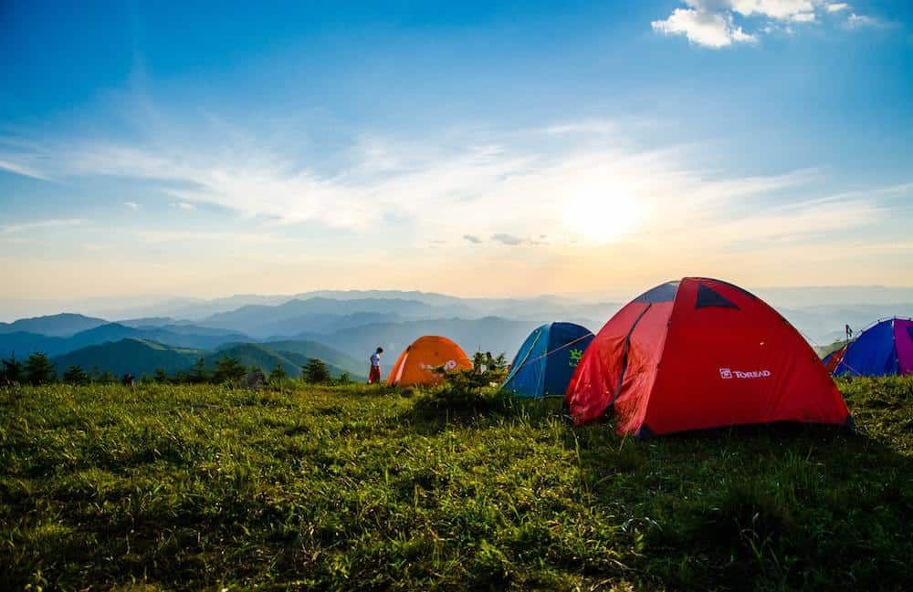 Tents on a hill overlooking skyline