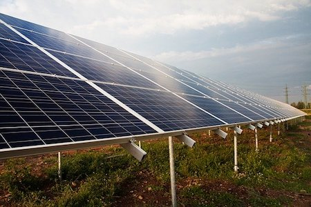 Solar panels connected in a field outdoors