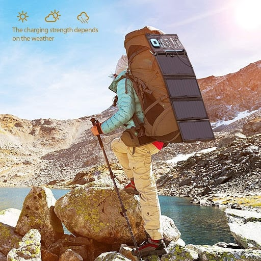 Backpacker with BigBlue 28W Solar Charger on backpack