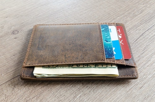 Brown wallet on table