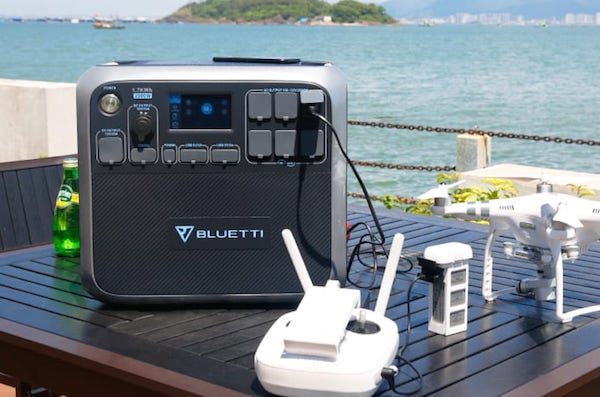 Bluetti AC200 with solar panels and drone